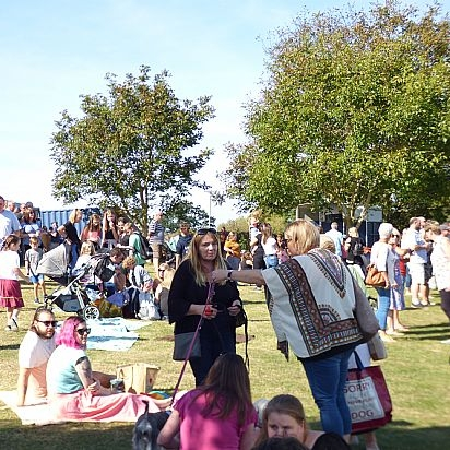 people at a sunny village fun day