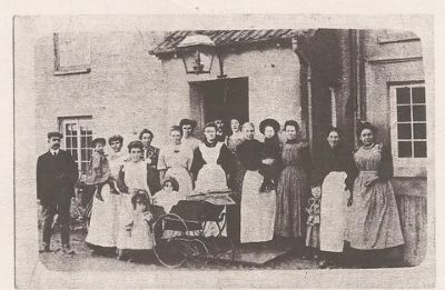 historical image of residents outside old building on Main Street